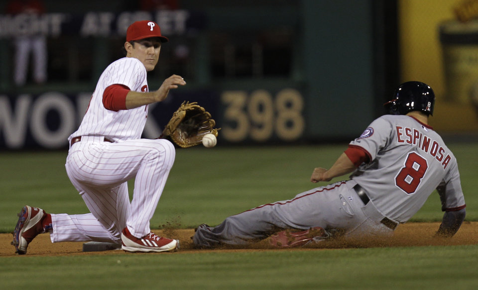 Photo - Washington Nationals' Danny Espinosa, right, is safe at second before Philadelphia Phillies' Chase Utley can make the tag in the seventh inning of a baseball game on Friday, May 2, 2014, in Philadelphia. Washington won 5-3. (AP Photo/Laurence Kesterson)