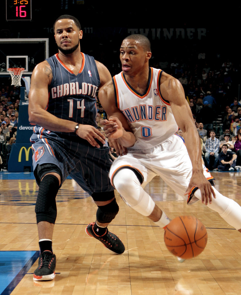 Oklahoma City Thunder's Russell Westbrook (0) drives past Charlotte Bobcats' D.J. Augustin (14) during the NBA basketball game between the Oklahoma City Thunder and the Charlotte Bobcats at Chesapeake Energy Arena in Oklahoma City, Saturday, March 10, 2012. Photo by Steve Sisney, The Oklahoman