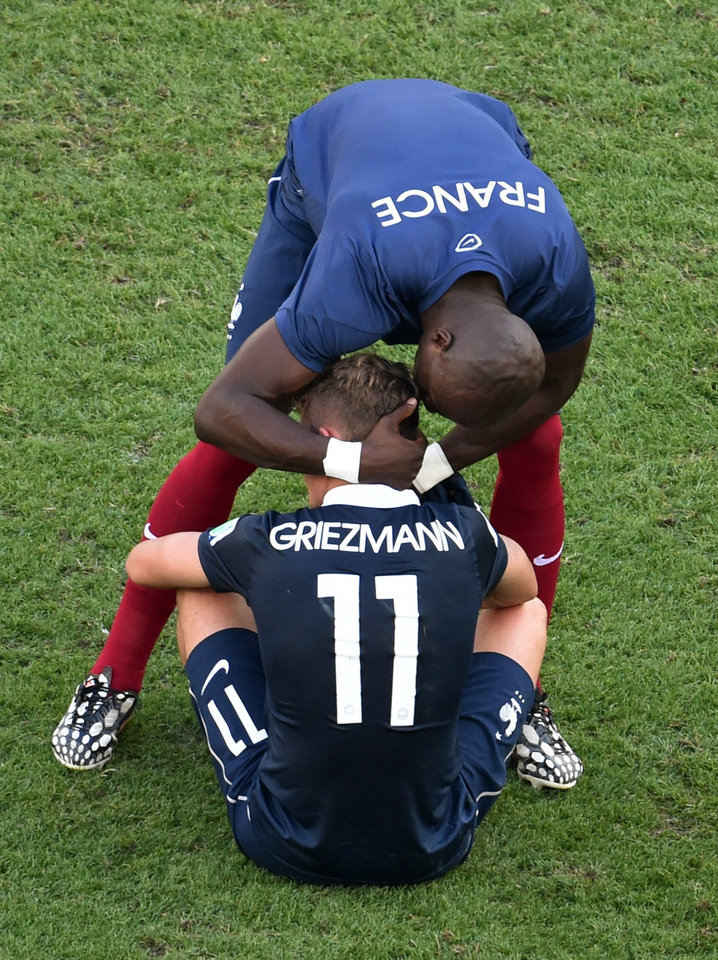 Photo - France's Antoine Griezmann is consoled by a team member after the World Cup quarterfinal soccer match between Germany and France at the Maracana Stadium in Rio de Janeiro, Brazil, Friday, July 4, 2014. Germany won 1-0. (AP Photo/Francois Xavier Marit, pool)