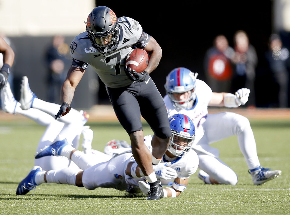 Photo - Oklahoma State's LD Brown (7) rushes in the third quarter during the college football game between the Oklahoma State University Cowboys and the Kansas Jayhawks at Boone Pickens Stadium in Stillwater, Okla., Saturday, Nov. 16, 2019. OSU won 31-13. [Sarah Phipps/The Oklahoman]