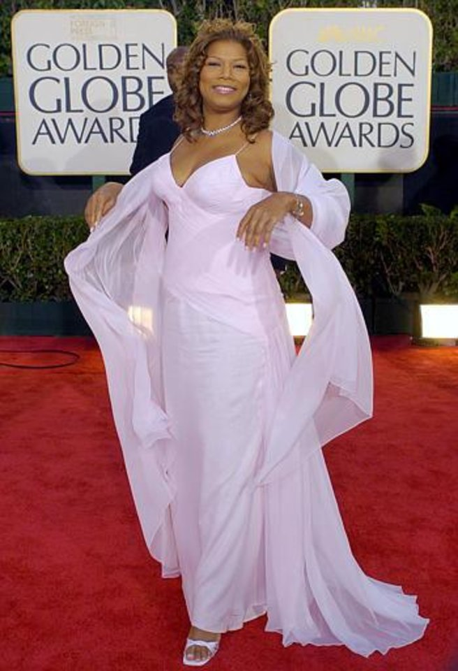 Presenter Queen Latifah arrives for the 61st Annual Golden Globe Awards on Sunday, Jan. 25, 2004, in Beverly Hills, Calif.  (AP Photo/Mark J. Terrill)