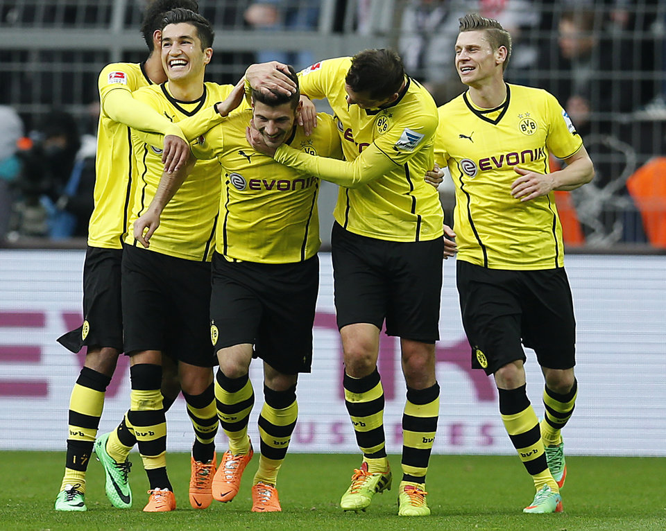 Photo - Dortmund's Milos Jojic of Serbia, center celebrates with teammates after scoring during the German first division Bundesliga soccer match between BvB Borussia Dortmund  and Eintracht Frankfurt in Dortmund, Germany, Saturday, Feb. 15, 2014. (AP Photo/Frank Augstein)