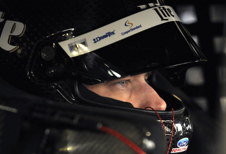 Photo - Sprint Cup driver Brad Keselowski waits in his car for the first round of practice to start for a NASCAR auto race at Martinsville Speedway in Martinsville, Va., Friday March 28, 2014. (AP Photo/Mike McCarn)