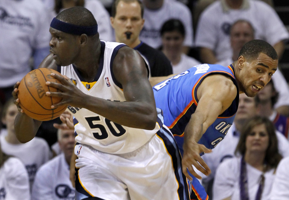 Memphis Grizzlies forward Zach Randolph (50) gets past Oklahoma City Thunder guard Thabo Sefolosha, of Switzerland, during the first half of Game 4 of a second-round NBA basketball playoff series on Monday, May 9, 2011, in Memphis, Tenn. (AP Photo/Lance Murphey)