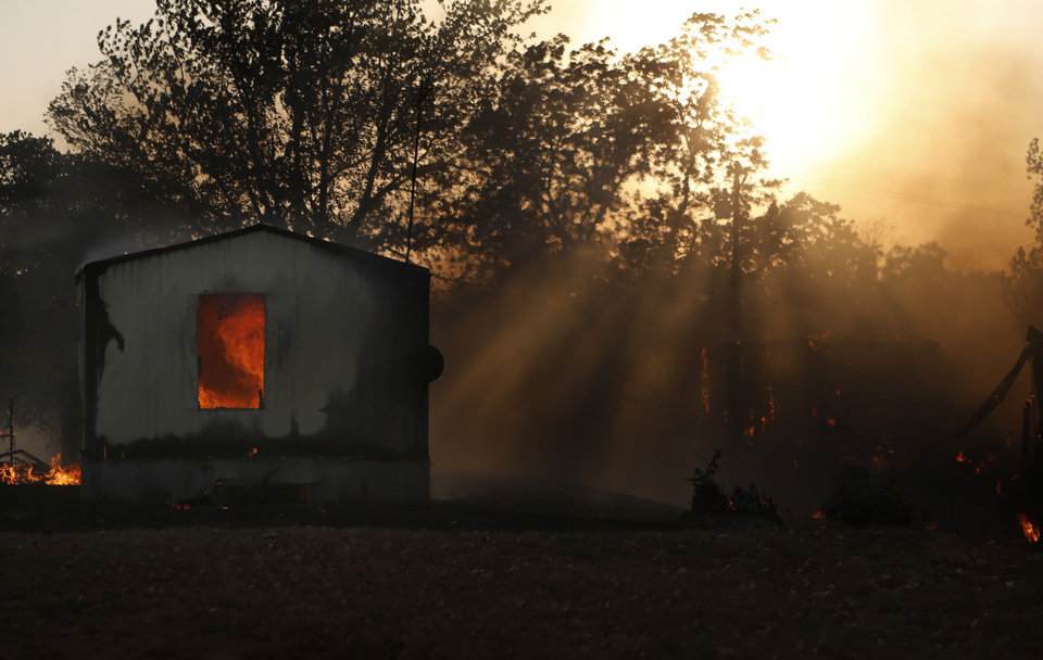 Photo - A mobile home burns in Luther, Okla.,  during a large wildfire Friday, Aug. 3, 2012. Photo by Sarah Phipps, The Oklahoman