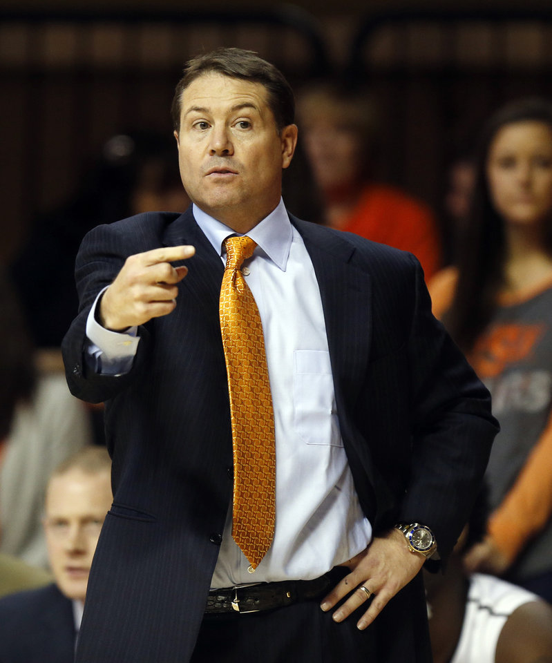 Photo - Oklahoma State men's basketball coach Travis Ford was ejected from a high school basketball game Thursday. (Photo by Nate Billings, The Oklahoman)