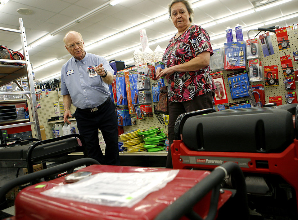Photo - SNOW / ICE / WINTER STORM / PREPARE / PREPARATION: Employee Bob Hooker (left) talks with Patricia Wallis, of Little Axe, about the selection of generators at Steve's Wholesale Tools in south Oklahoma City on Wednesday, Jan. 26, 2010. Patricia is looking for a generator strong enough to power a water well and her husband's oxygen supply. Photo by John Clanton, The Oklahoman ORG XMIT: KOD