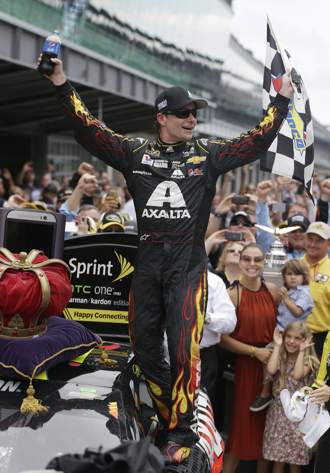 Photo - Jeff Gordon celebrates after winning the NASCAR Brickyard 400 auto race at Indianapolis Motor Speedway in Indianapolis, Sunday, July 27, 2014. (AP Photo/Darron Cummings)
