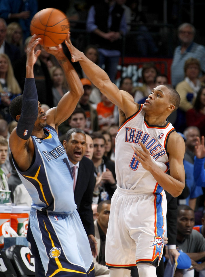 Oklahoma City's Russell Westbrook (0) defends Memphis' Mike Conley (11) during the NBA game between the Oklahoma City Thunder and the Memphis Grizzlies at Chesapeake Energy Arena in Oklahoma CIty, Friday, Feb. 3, 2012. Photo by Bryan Terry, The Oklahoman