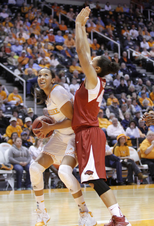 Photo - Tennessee's Mercedes Russell, left, looks to the basket under pressure from Arkansas' Jhasmin Bowen during the first half on an NCAA college basketball game, Thursday, Jan. 30, 2014 in Knoxville, Tenn. (AP Photo/The Daily Times, Daryl Sullivan)