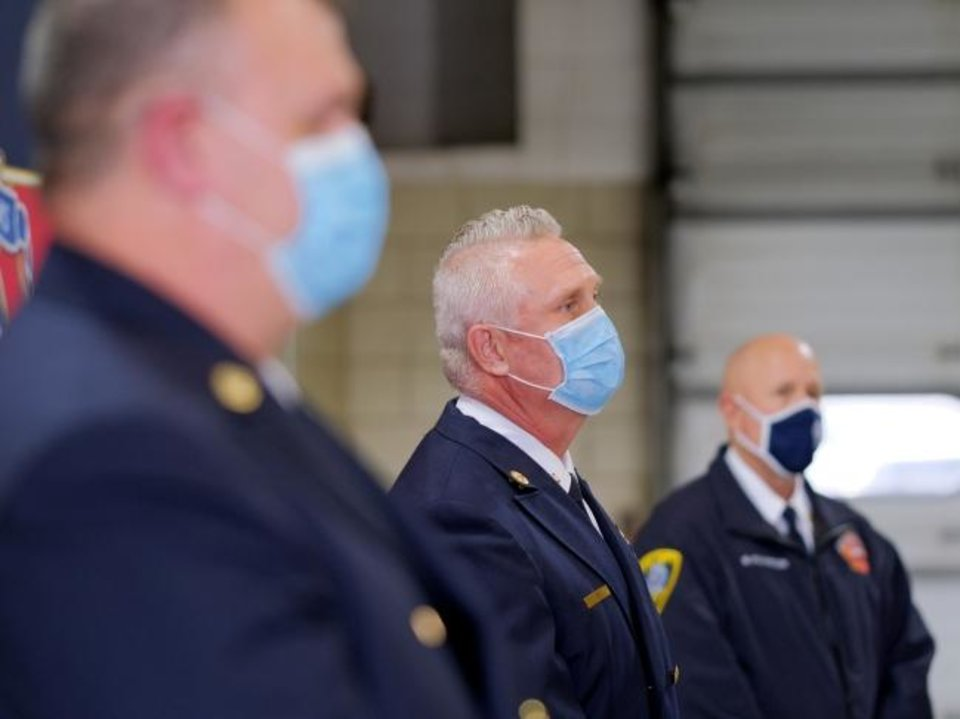 Photo -  Oklahoma City Fire Department officials, including Deputy Chief of Operations Michael Walker, Fire Chief Richard Kelley and Battalion Chief Benny Fulkerson listen to Mayor David Holt during a press conference Monday regarding last week's death of Maj. Andy Davis from COVID-19, and explaining the agency's vaccination process. [DOUG HOKE/THE OKLAHOMAN]