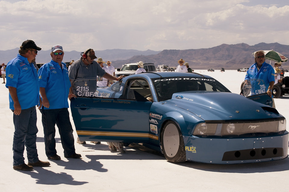 Photo - ETHANOL-FUELED CAR / FUEL: Brent Hajek, left and E85 Mustang crew members perform final checks at the starting line at Bonneville Salt Flats, Utah, just before the car's 252 mph run. PHOTO PROVIDED BY PATRICK QUIRK     ORG XMIT: 0812252227092884