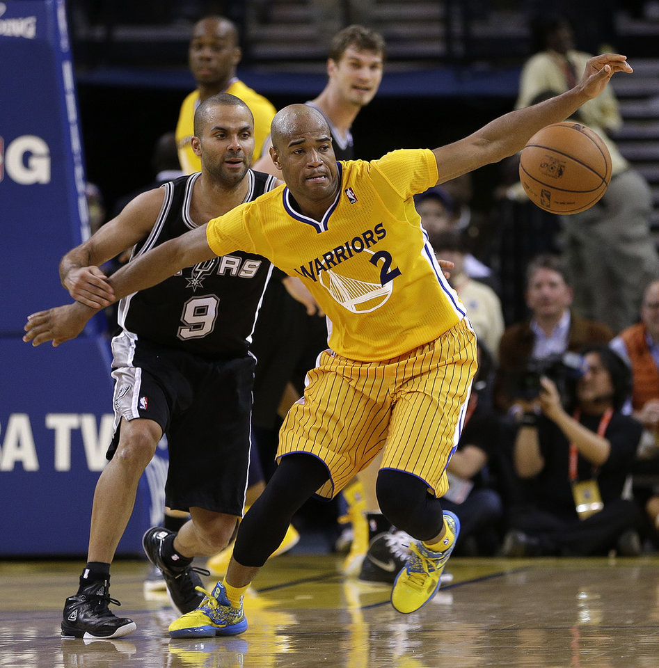 Photo - San Antonio Spurs' Tony Parker (9) and Golden State Warriors' Jarrett Jack, right, eye a loose ball during the second half of an NBA basketball game Friday, Feb. 22, 2013, in Oakland, Calif. (AP Photo/Ben Margot)