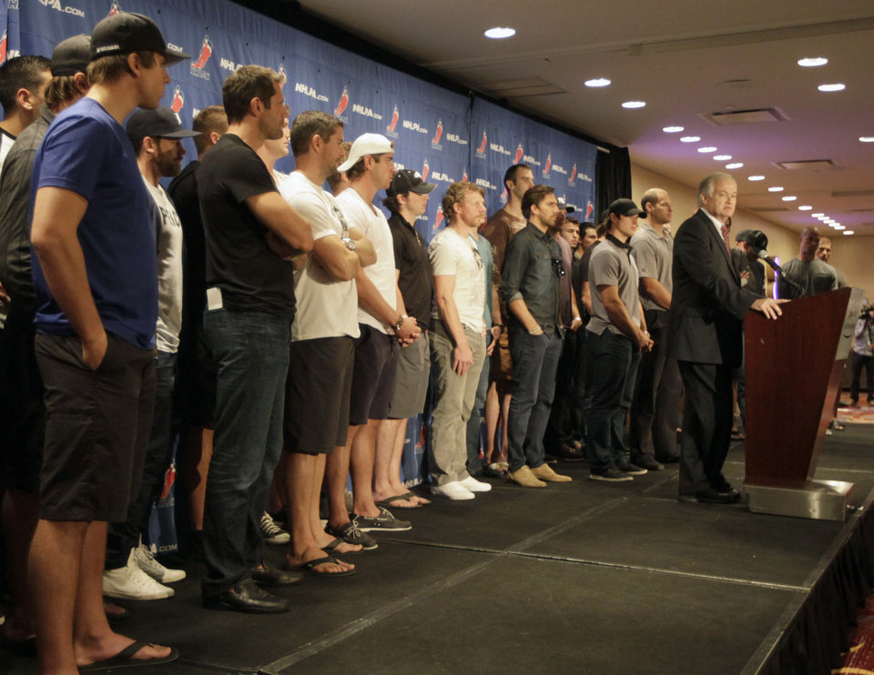 Photo -   NHL Players Association executive director Donald Fehr, right, is joined by hockey players as he speaks to reporters during a news conference in New York, Thursday, Sept. 13, 2012. Fehr says a lockout can be avoided and that's up to the league. (AP Photo/Mary Altaffer)
