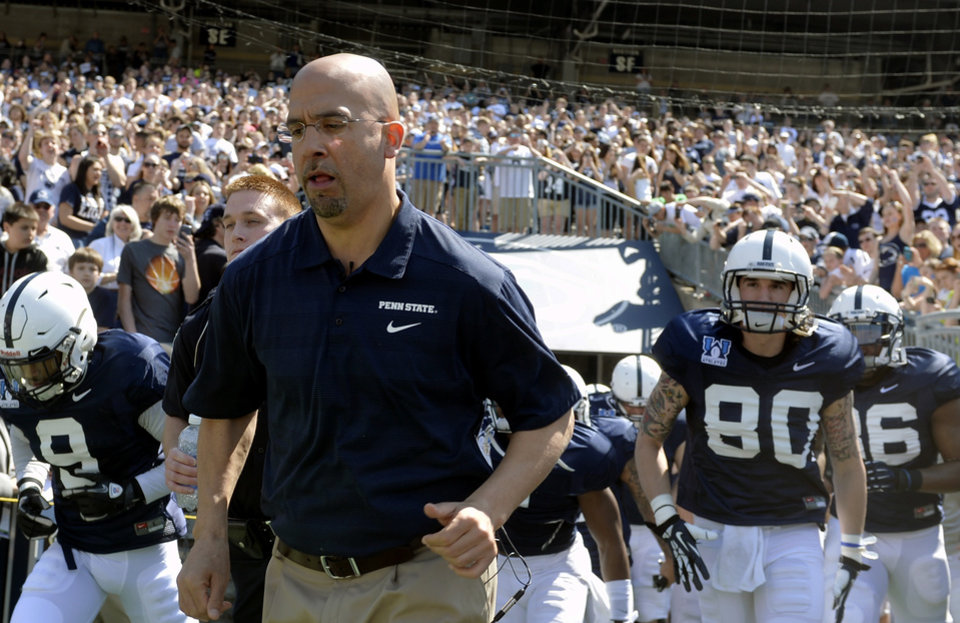 Photo - New Penn State head football coach James Franklin leads the team onto the field at Beaver Stadium for the Blue-White game on Saturday, April 12, 2014. The Blue Squad defeated the White Squad 37-0 in the 2014 Blue-White game, Penn State's spring football scrimmage. The game was also new head coach James Franklin's first in Beaver Stadium.(AP Photo/York Daily Record, Chris Dunn)  YORK DISPATCH OUT