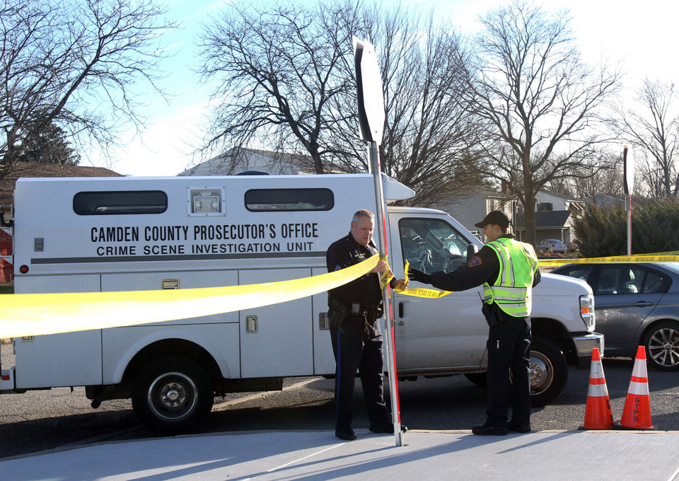 Photo - The Camden County Prosecutor's Office Crime Scene Investigation Unit ropes off an area as authorities continue their investigation where three officers were injured in a shooting at the Gloucester Township police station, and the suspect was shot and killed, Friday, Dec. 28, 2012, in Gloucester Township, N.J. (AP Photo/South Jersey Times, Lori M. Nichols) PHILLY METRO OUT NEWS