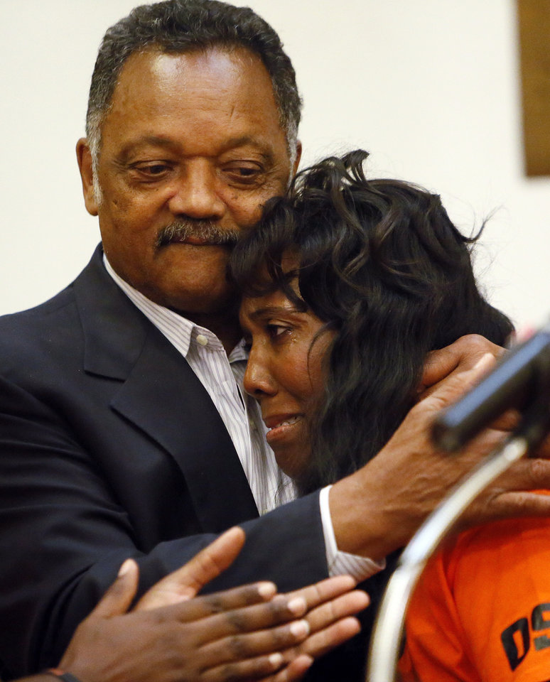 Photo - Rev. Jesse Jackson embraces Alice Williams, mother of Darrell Williams, during a rally in support of Darrell Williams at Mt. Zion Baptist Church in Stillwater, Okla., Thursday, Aug. 23, 2012. Williams, a suspended Oklahoma State basketball player, was found guilty on two counts of rape by instrumentation and one count of sexual battery after an incident at a house party. Photo by Nate Billings, The Oklahoman