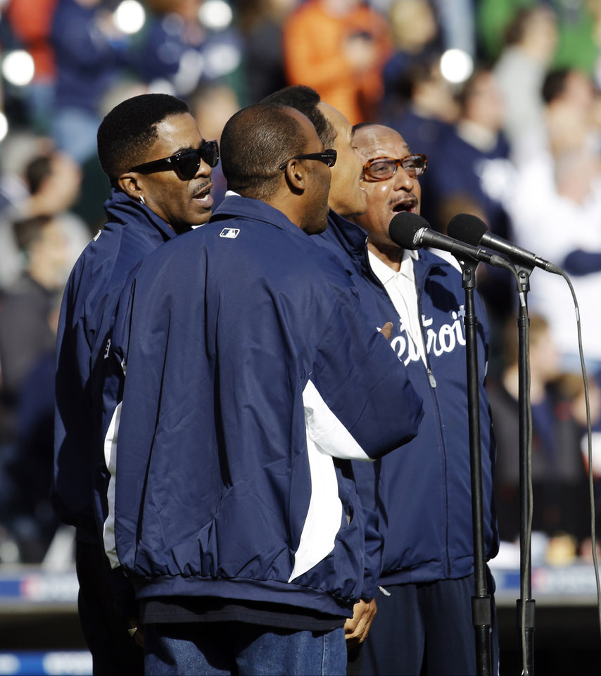 Photo -   The Four Tops sing the national anthem before Game 4 of the American League championship series between the Detroit Tigers and New York Yankees Thursday, Oct. 18, 2012, in Detroit. (AP Photo/Paul Sancya )