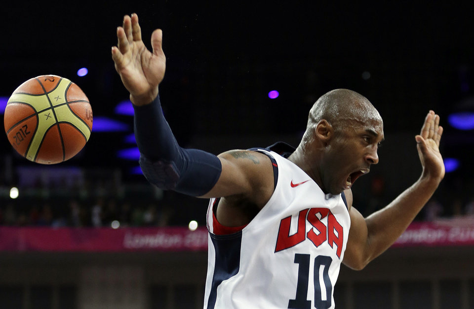 United States' Kobe Bryant reacts after a dunk during a men's gold medal basketball game against Spain at the 2012 Summer Olympics, Sunday, Aug. 12, 2012, in London. (AP Photo/Eric Gay)