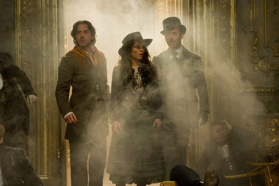 "In this film image released by Warner Bros. Pictures, from left, Robert Downey Jr., Noomi Rapace, and Jude Law are shown in a scene from ""Sherlock Holmes: A Game of Shadows."" (AP Photo/Warner Bros. Pictures, Daniel Smith)  ORG XMIT: NYET213"