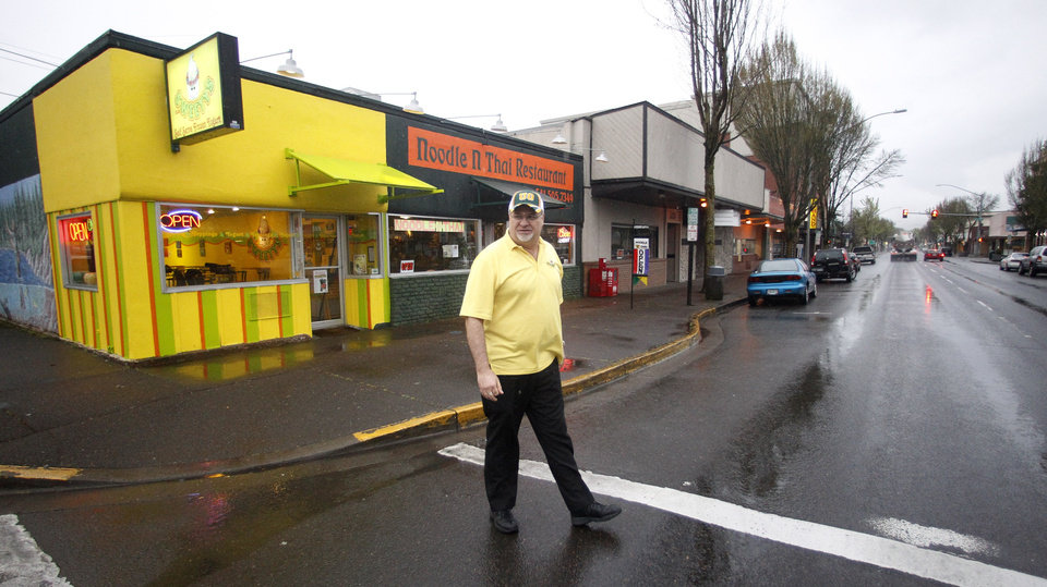 Photo -   Jack Kohler crosses Main Street Tuesday, April 10, 2012, in downtown Springfield, Ore. One of the best-kept secrets in television history has been revealed, with