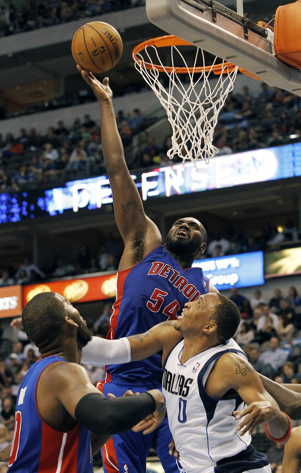 Detroit Pistons forward Jason Maxiell (54) attempts a layup as Dallas Mavericks forward Shawn Marion (0) defends during the first half of an NBA basketball game, Saturday, Dec. 1, 2012, in Dallas. (AP Photo/Brandon Wade)