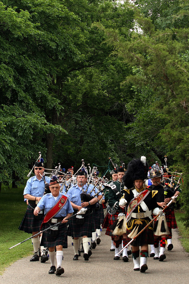 Members of several Pipe and Drum bands march during the Iron Thistle Festival in Yukon, Saturday, April 28th, 2012. PHOTO BY HUGH SCOTT, FOR THE OKLAHOMAN  ORG XMIT: KOD