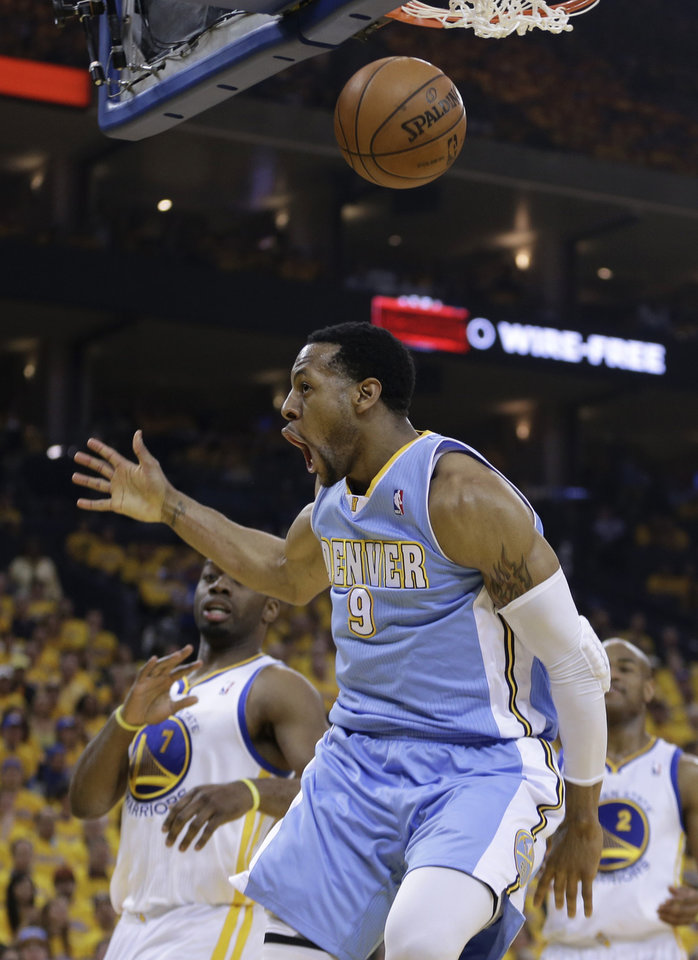 Photo - Denver Nuggets guard Andre Iguodala (9) reacts after scoring against the Golden State Warriors during the first half of Game 4 in a first-round NBA basketball playoff series, Sunday, April 28, 2013, in Oakland, Calif. (AP Photo/Ben Margot)