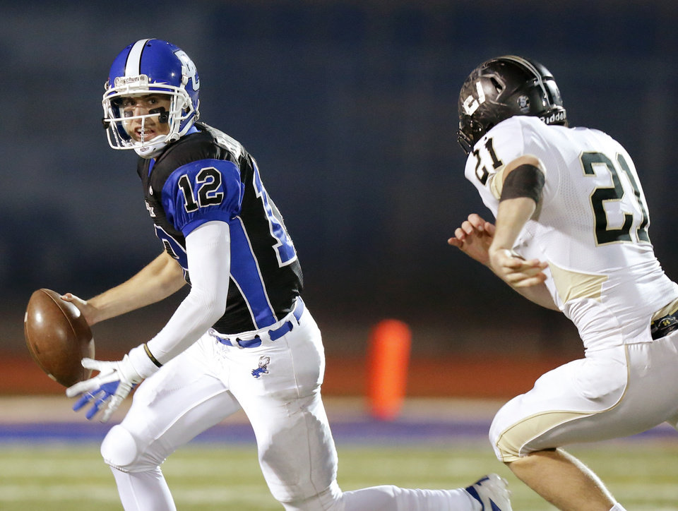 Photo - Deer Creek's Joel Blumenthal looks to throw as McAlester's Seth Grant chases him during a high school football playoff game at Deer Creek, Friday, Nov. 16, 2012. Photo by Bryan Terry, The Oklahoman