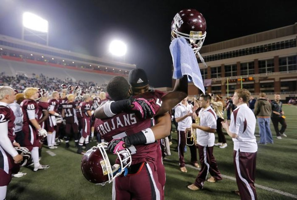 Jenks' Jordan Smallwood (2) and Trey'Vonne Barr'e (5) celebrate the win over Norman North during the Class 6A Oklahoma state championship football game between Norman North High School and Jenks High School at Boone Pickens Stadium on Friday, Nov. 30, 2012, in Stillwater, Okla.   Photo by Chris Landsberger, The Oklahoman