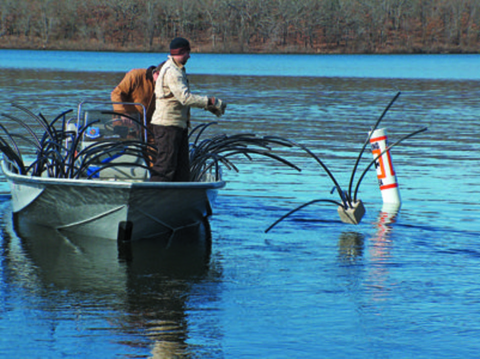 Photo - Oklahoma Department of Wildlife Conservation employees make and place spider blocks in lakes to attract fish for anglers. PHOTO PROVIDED