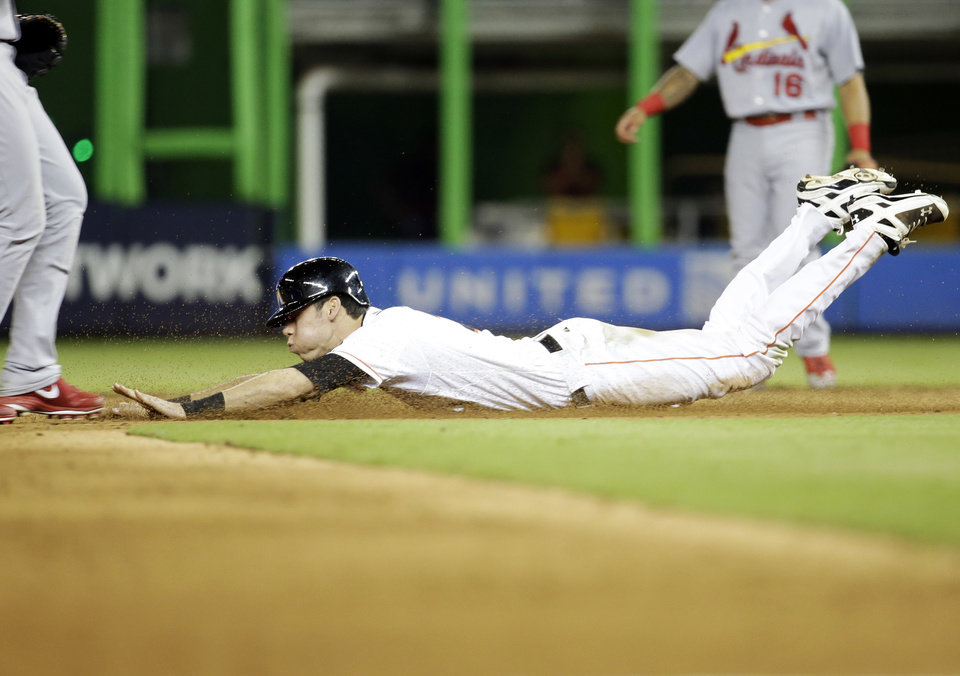 Photo - Miami Marlins' Christian Yelich is safe stealing second in the fourth inning during a baseball game against the St. Louis Cardinals, Monday, Aug. 11, 2014, in Miami. (AP Photo/Lynne Sladky)