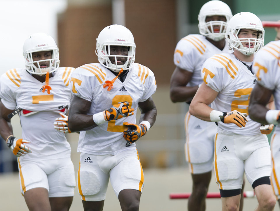 Photo - University of Tennessee wide receiver Pig Howard, second from left, takes part in a drill with other players including Ryan Jenkins, left, and Josh Smith during during NCAA college football practice Monday, Aug. 11, 2014, in Knoxville, Tenn. (AP Photo, Paul Efird/Knoxville News Sentinel)