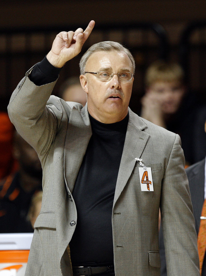 Photo - Oklahoma State Interim head coach Jim Littell coaches the women's college game between Oklahoma State University and Coppin State at Gallagher-Iba Arena in Stillwater, Okla.,  Saturday, Nov. 26, 2011.  Photo by Sarah Phipps, The Oklahoman