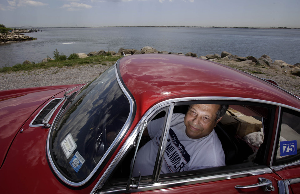 Photo -   ***HOLD FOR FAY ABUELGASIM STORY*** Irv Gordon poses for a picture in his Volvo P1800 in Babylon, N.Y., Monday, July 2, 2012. Gordon's car already holds the world record for the highest recorded milage on a car and he is less than 40,000 miles away from passing three million miles on the Volvo. (AP Photo/Seth Wenig)