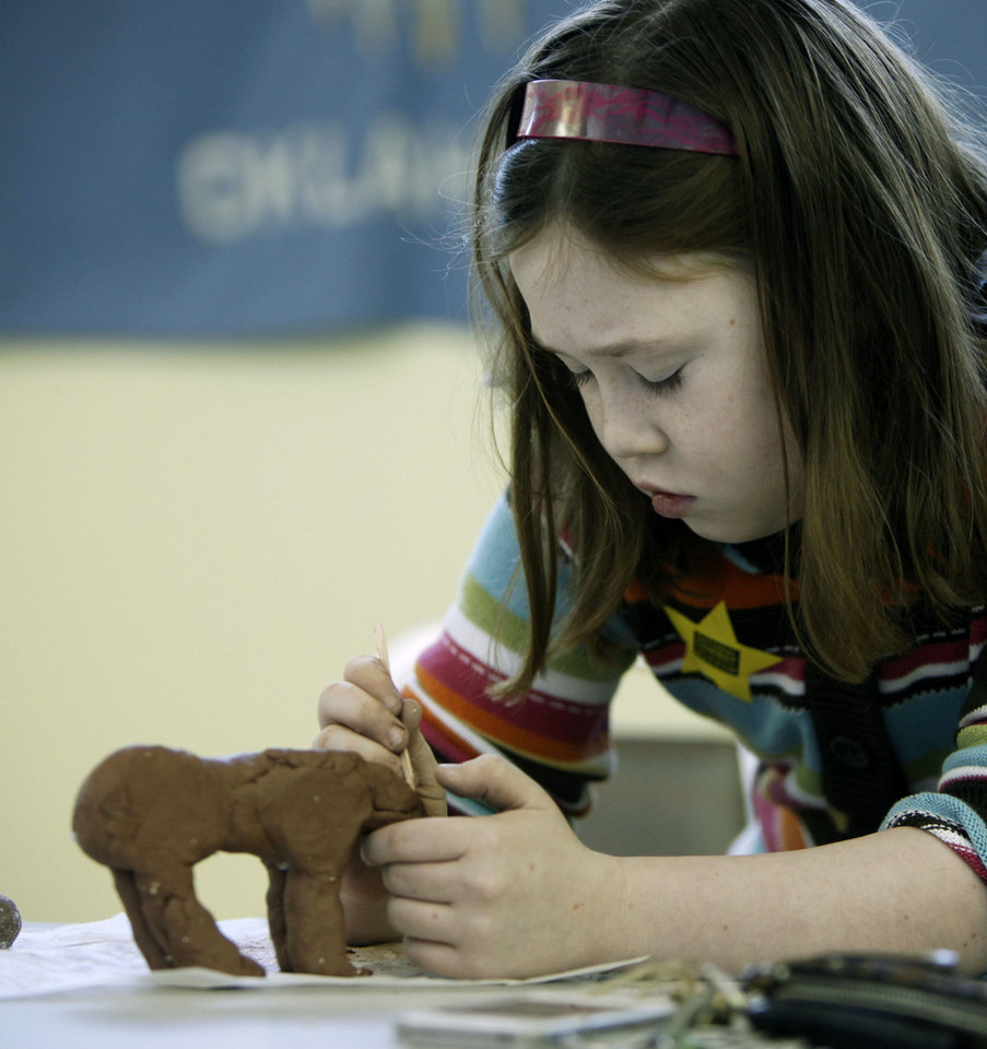 Right: Mattie Elerick, 8, creates a sculpture.