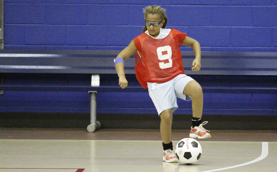 Steffani McGee, 9, controls the ball during a soccer camp scrimmage at Oklahoma City Community College in Oklahoma City, Monday 16, 2012. Photo By Steve Gooch, The Oklahoman