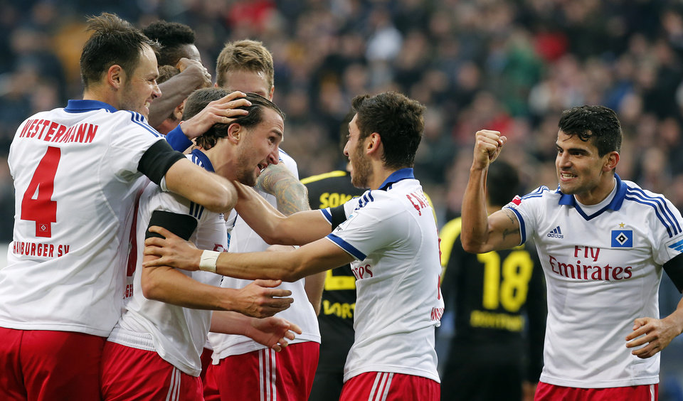 Photo - Hamburg's Petr Jiracek of Czech Republic celebrates with treammates after scoring during the German first division Bundesliga soccer match between Hamburg SV and BvB Borussia Dortmund in Hamburg , Germany, Saturday, Feb. 22, 2014. (AP Photo/Frank Augstein)