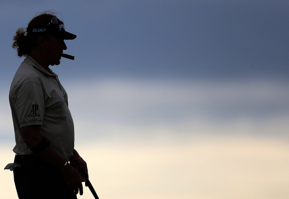 Photo - Spain's Miguel Angel Jimenez lines his putt on the 13th green during a practice round at the Royal Liverpool Golf Club prior to the start of the British Open Golf Championship, in Hoylake, England, Monday, July 14, 2014. The 2014 Open Championship starts on Thursday, July 17. (AP Photo/Scott Heppell)