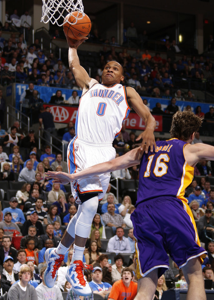 Oklahoma City's Russell Westbrook (0) goes to the basket beside Los Angeles' Pau Gasol (16) during an NBA basketball game between the Oklahoma City Thunder and the Los Angeles Lakers at Chesapeake Energy Arena in Oklahoma City, Thursday, Feb. 23, 2012.   Oklahoma City won 100-85. Photo by Bryan Terry, The Oklahoman