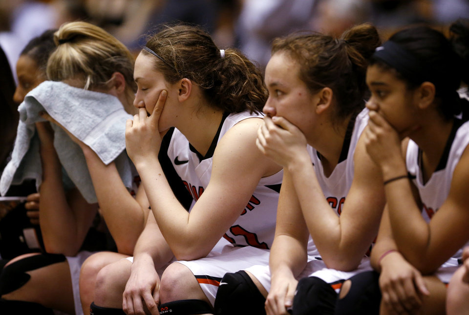Photo - Members of the Princeton women's basketball team watch the final seconds of an NCAA college basketball game against Penn, Tuesday, March 11, 2014, in Princeton, N.J. Penn won 80-64 to win the Ivy League title. (AP Photo/Julio Cortez)