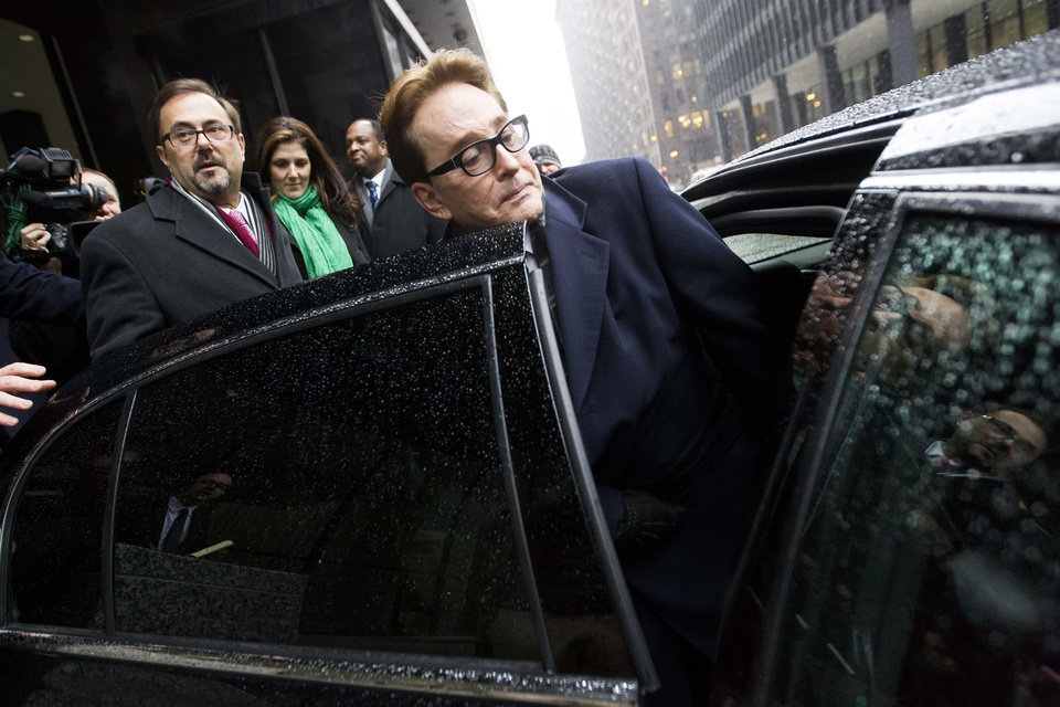 Photo - H. Ty Warner, the billionaire who created Beanie Babies, gets into a car outside the federal building in Chicago, Tuesday, Jan. 14, 2014, after being sentenced to two years of probation, but no prison time, for tax evasion on $25 million in income he had in Swiss bank accounts. (AP Photo/Andrew A. Nelles)