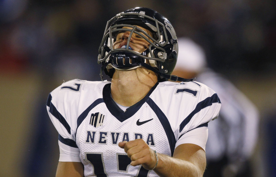 Photo -   Nevada quarterback Cody Fajardo reacts after throwing an interception to Air Force defensive back Brian Lindsay to end Nevada's final drive in the fourth quarter of Air Force's 48-31 victory in an NCAA college football game in Air Force Academy, Colo., on Friday, Oct. 26, 2012. (AP Photo/David Zalubowski)