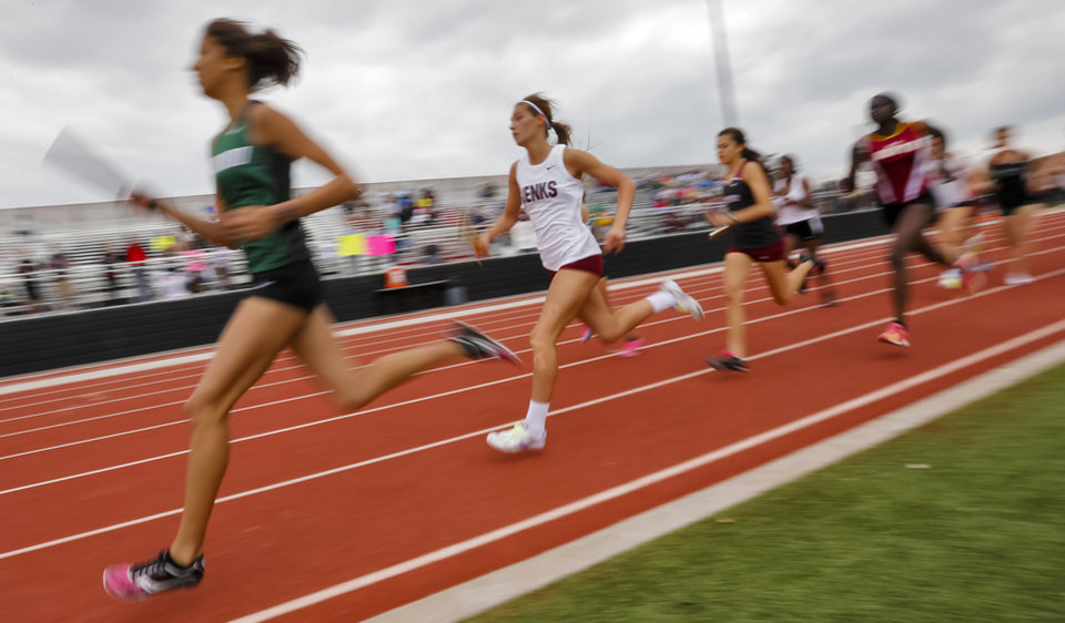 Photo - Members of the class 6A girls 4x800m relay run during the class 5A and 6A track state championships at Yukon High School on on Friday, May 10, 2013, in Yukon, Okla.Photo by Chris Landsberger, The Oklahoman