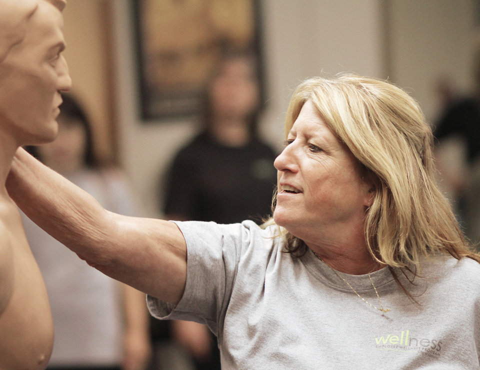 "Terry Lanham practices her punches on ""Bob""  during a four-week self defense class that is part of a wellness program for female Edmond city employees at the Edmond police training center Thursday, April 19, 2012. Photo by Doug Hoke, The Oklahoman ORG XMIT: OKOKL"