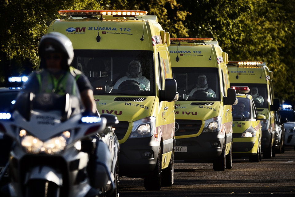 Photo - An ambulance transporting Miguel Pajares, a Spanish priest who was infected with the Ebola virus while working in Liberia, leaves the Military Air Base of Torrejon de Ardoz, near Madrid, Spain, Thursday, Aug. 7, 2014 after his arrival in Spain. A priest who has been confirmed as the first Spaniard to be infected by the current outbreak of the ebola virus has been brought back to Spain for treatment. Pajares, a missionary priest based in Liberia, is one of the 1,711 reported cases to have been confirmed since March, when the most deadly wave of the condition began. As well as Liberia, where Pajares was based, the epidemic is also affecting Sierra Leone and Nigeria, with nearly 932  deaths reported so far. (AP Photo/Daniel Ochoa de Olza)