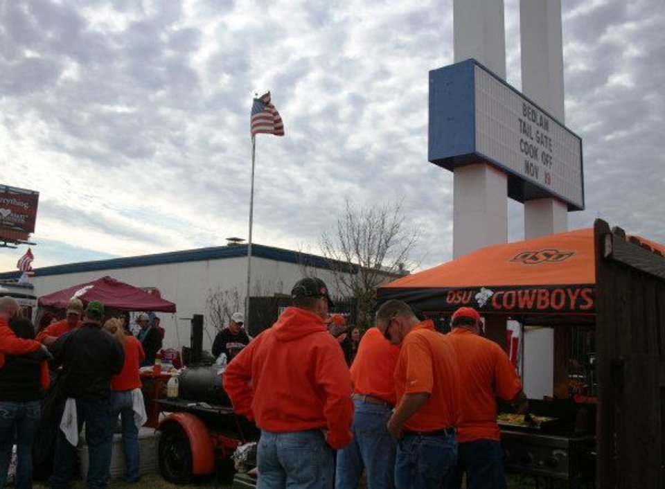 Cowboys fans gather around the Kingfisher tailgate during the Bedlam Tailgating Showdown. <strong>DAVE CATHEY - THE OKLAHOMAN</strong>