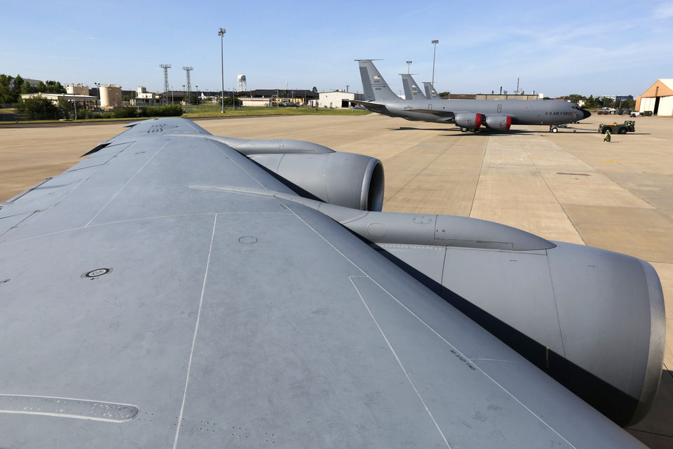 Photo -  A KC-135 Stratotanker at Tinker Air Force Base is readied for a practice flight. During the flight, the tanker rendezvoused with a B-52 Stratofortress from Barksdale Air Force Base, which is near Bossier City, La. [Photo by Paul Hellstern, The Oklahoman]