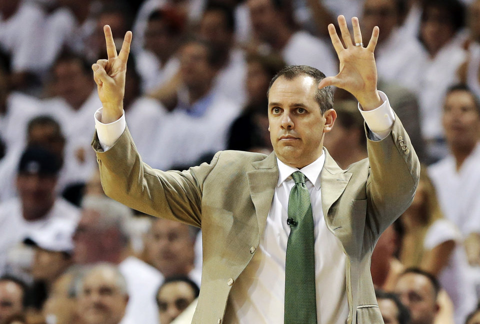 Photo - Indiana Pacers head coach Frank Vogel gestures during the first half of Game 1 in their NBA basketball Eastern Conference finals playoff series against the Miami Heat, Wednesday, May 22, 2013 in Miami. (AP Photo/Lynne Sladky)