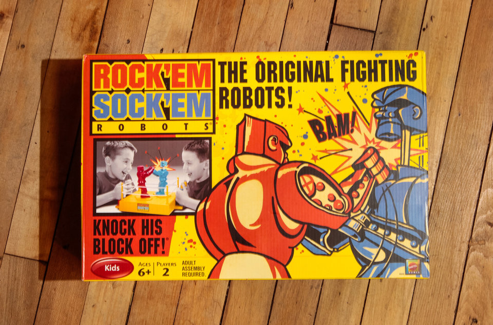 Photo - Retro toys have made a comeback among kids in the 2012 holiday shopping season, including Rock 'Em Sock 'Em Robots at Mast General Store in Columbia, South Carolina. (Tim Dominick/The State/MCT)